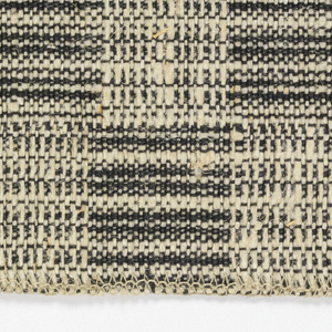 Plaid of squares and rectangles in contrasting warp and weft-faced weaves, in combinations of black warp and white weft.