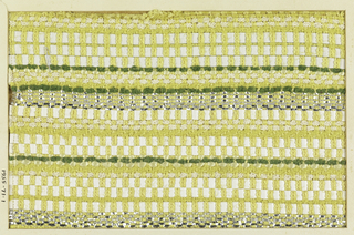 Woven sample with horizontal stripes of white, yellow and green. Warps are heavy pale yellow; wefts are white leather strips, white braided cord, green chenille, and yellow plied yarns, silver flat metallic strips and silver-wrapped silk-core yarns.