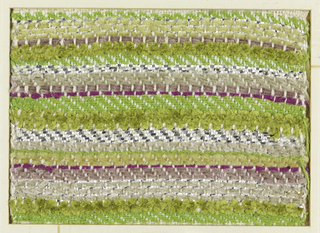 Woven sample with horizontal stripes of tans, greens and bright fuchsia. Warp is white silk; wefts are thin tan, off-white, and fuchsia chenille, bright green synthetic yarn, very thick yellow-green chenille, silver flat metallic strips, and silver-wrapped silk-core threads.