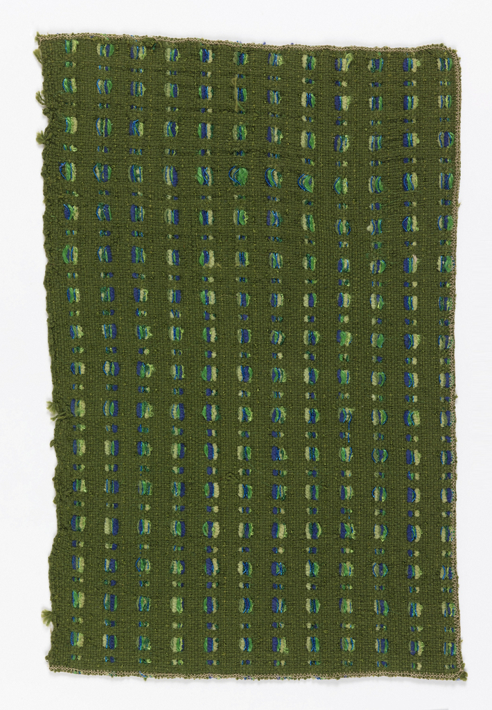 Closely woven dull green warp and weft, with a second pattern warp in groups of purple, green, and metallic yarn, floating in and out of the ground to form an interrupted vertical stripe.