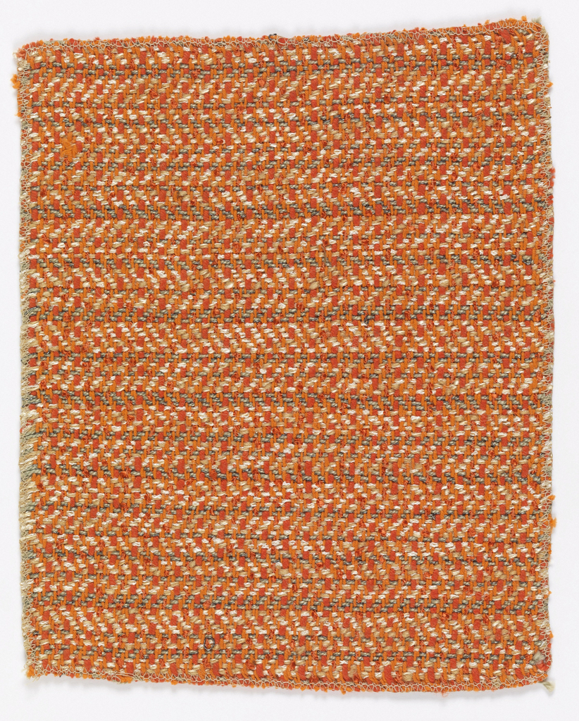 Closely woven, heavy, weft chevron twill, predominantly orange.