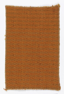 Heavy, closely woven fabric in shades of orange.