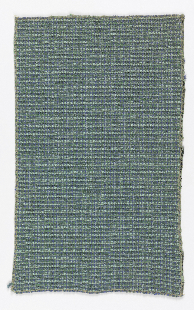 Yarns in shades of green and blue, heavy and rough-textured.