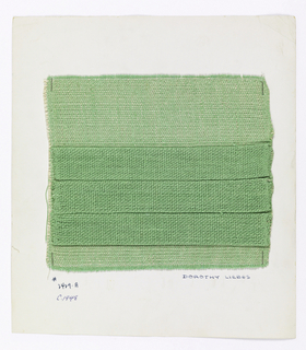 Light green textile with three dark green tubular plain weave flaps on the surface. Warp was alternately wound on two different beams. Flaps were formed by releasing tension on one beam while maintaining it on the other. Warp is two-ply green yarn. Weft is white two-ply yarn with green two-ply yarn for tubular flaps.