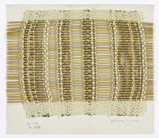 Plain weave with spaced warps of white boucle, white chenille, white two-ply yarn, flat silver metallic threads, silver metallic yarn wrapped over central core, and two different metallic gold braids. The sequence of stripes does not repeat from left to right. Wefts are round reeds.