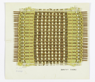 Sample in plain weave with paired and other multiple warps in yellows and metallic yarns. Warps include yellow chenille, yellow boucle, and two different yellow smooth yarns, green and white two-ply yarn, white smooth yarn, two flat metallic braids, narrow wrapped metallic gold. Wefts are reeds.
