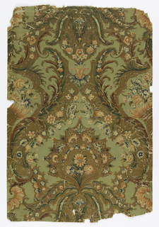 On light gray-green background, embossed in imitation of leather, large curving foliate pattern, vertically symmetrical along central palmette in brown, with gilded ornamental fill patterns, this palmette enframed in leafy S-curves. Three feathers of junctuire of two opposed S-curves. Scattered symmetrically, blue and white and orange-red and white flower with green leaves. At edges of length, halves of patterns which, joined, form vase of horn containing flowers.