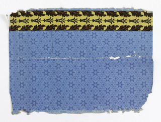 At left edge, yellow column with black flock acanthus leaves, overprinted with orange. Sidewall design contains deep blue stars and framework on blue ground.