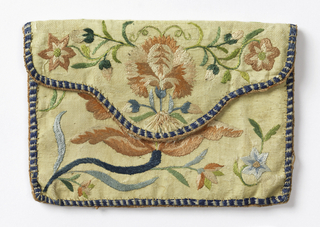 Card case of pale yellow silk embroidered in pink, blue and green silk in a floral design; lined with pale blue silk.