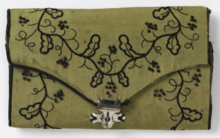 Sewing case in the form of a pocket book with a metal clasp. Cover of green silk taffeta with embroidery in black silk with beads. LIning of white silk with black feather-stitch.