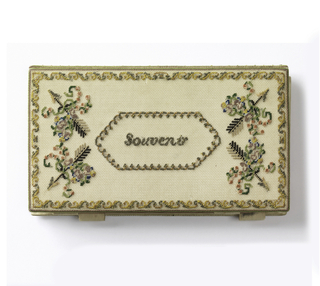 "Pocket book with embroidered cover. Cover on one side shows initials ""S.A.M."" within a floral border. On the other, the word ""Souvenir"" and four arrows with flowers and ribbons within border working on fine silk canvas. Lining is white satin. Satin covered book of white paper and pencil held in place by four satin straps that are fitted inside the pocket book."