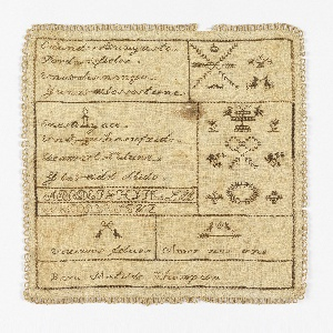 Sampler is divided into compartments with vases, birds, and flowers. Those compartments with text are composed in the form of a rebus or pictogram. Sampler is edged with tatting. Contains the following text in Spanish:  Cuando se (corona) un gusto Por dos (corazónes) fieles Una (llave) los maneja Y una (flecha) los sostiene  En este (urna) yace Un (corazón) que ha sufrido De amor lo (cadena) dura Y la (flecha) del olbido  Vivimos felices Amor nos une  Para Matilde Thompson  English translation:  When a desire is (crowned) By two faithful (hearts) A (key) controls them And an (arrow) sustains them  In this (urn) rests A (heart) that has suffered From love's cruel (chains) And the (arrow) of forgetfulness  We live happily Love unites us  For Matilde Thompson