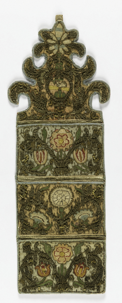Wall pocket with three pockets and highly ornamental shaped top. Two pockets of pale blue silk, one of faded rose, embroidered in symmetrical floral designs in silk and heavy gold thread and looped wire. At the top a small bird in an elaborate enframement. Bound with blue silk tape and lined with pale pink linen.