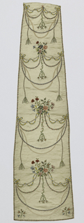 Long, narrow shaped panel of white satin decorated with ribbon embroidery and silk thread. Designs of delicate festoons of flowers and ribbons extend almost entirely across the panel, primarily in narrow ribbons instead of silk thread. Some festoons of dots outlined in metallic thread.