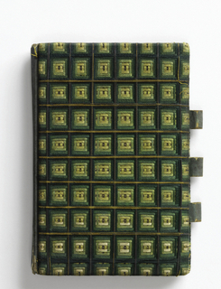 Small notebook covered in silk thread in shades of green, yellow and gold in a grid-like design outlined with gold. The threads are laid tightly across the surface of the cardboard in groups. Three loops to hold a pencil, space inside for notes.