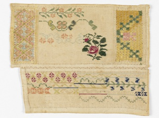Two separate pieces of cloth containing floral and geometric motifs and one alphabet joined together with decorative stitchery.