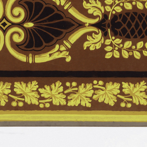 Two borders printed side by side on the length of paper. Central motif is a mirror image of a modified scissors scroll decorated with elements derived from pineapple, bay, and palm leaf. This motif is enclosed by black lines ending in Greek key patterns. Above is a string of beads, below, a band of grape leaves. Yellow and black on chocolate ground.