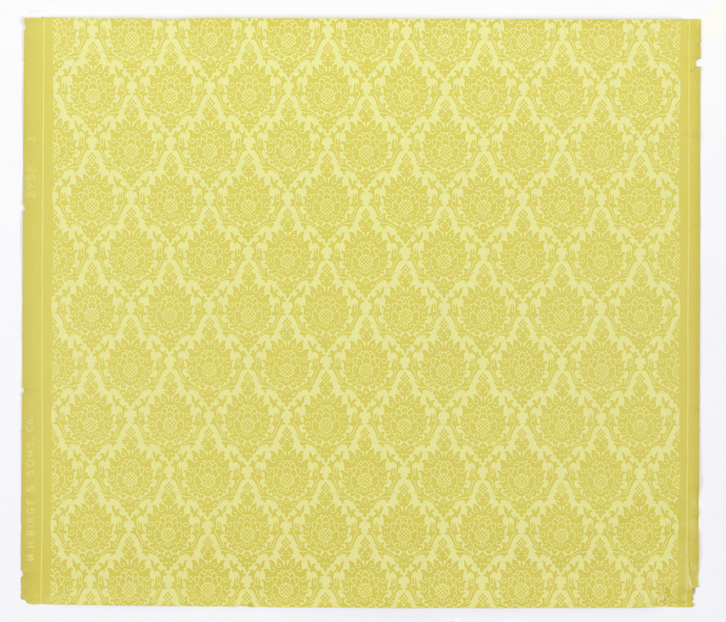 Diaper pattern formed by repeating design of floral medallion printed in pale yellow on mustard yellow ground.
