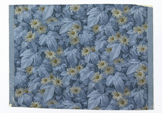All-over design of pointed three-lobed leaves in blue, and cluster of blue daisies with brown centers touched with gold. Printed in blues, brown and gilt, on blue ground.