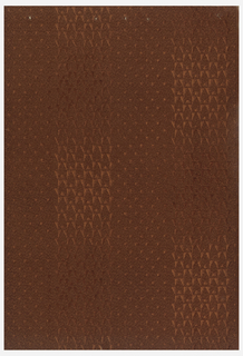 Textured red-terracotta paper.