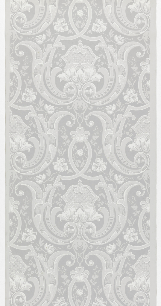 Drop repeating motif. A large symmetrical foliate and strapwork frame enclosed a symmetrical diapered medallion, the base of which is enfolded in large leaves. Trailing roses in the spaces around the frames. Printed on gray ground.