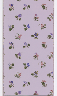On pale lavender ground, stylized multi-colored (2 shades pink, 2 shades blue, maroon, red, yellow, 2 shades green, beige) floral sprigs in regular rows.