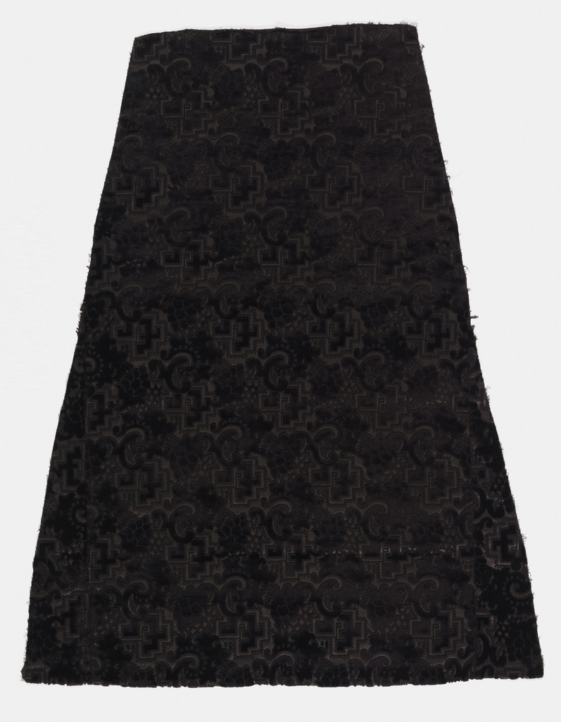 Wedge-shaped piece of brown silk velvet as for a skirt. Asymmetrical pattern of geometric forms, fruit and s-curves.