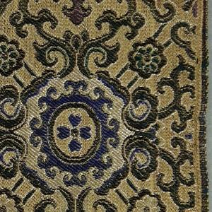 Allover geometric latticework design in blue, purple, green and light gray on a tan ground.