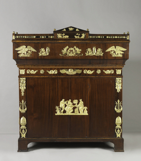 With slant front upper desk portion, with flame-grained matched mahogany veneers below a raised gilt-metal gallery with brass knop finials that elevates on racheted supports; the interior with contrasting maple writing surface and burl veneers and drawer fronts, with ormolu borders and document drawer fronts, the sides of the top with eagle and lyre mounts, resting on a cabinet base with matched flame-grained veneered doors with lyre form mounts at the centers of the front and sunburst on centers of the sides, trophy mounts on upper and  acorn mounts on lower corners, the interior with shelves, on square bracket feet below a band of branded leaf-tip decoration.