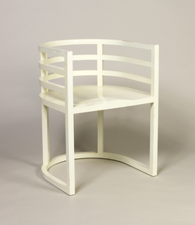 White painted wood barrel shaped armchair.