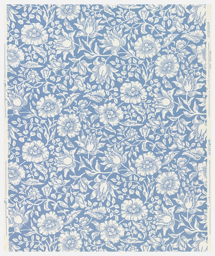 Vertical repeat of arabesque with two different types of flowers. Printed in blue on white ground.