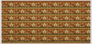 Wallpaper roll. Printed six across, leaf motifs separated by tassels. Printed in colors on orange ground.