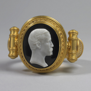 Gold bracelet set with pietra dura portrait of Frederick Augustus Chauncey, father of donor. Cameo separates to become brooch or pendant.