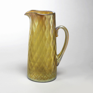 Gold iridescent pitcher with diamond pattern, applied light blue handle.