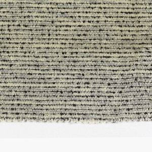 Hand-woven upholstery sample. Variety of weft yarns in off-white, gray and black give textured horizontal bands.