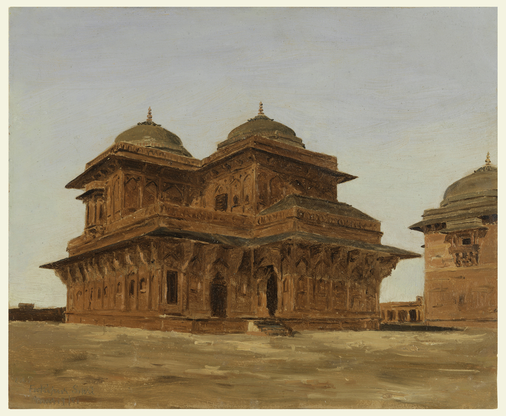 Ochre buildings seen from corner situated in sandy landscape.  Central building has two stories, each accentuated with projecting cornices and large brackets beneath.  Roofline culminates in twin domes.  A portion of another building in a similar architectural style is seen at right.  It has a projecting balcony and similar roofline and dome.  All buildings seem to be part of a larger complex.