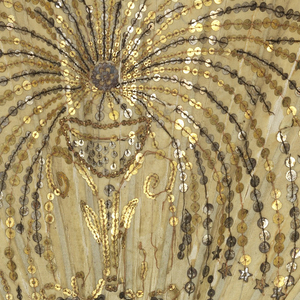 Pleated fan with off-white silk leaf and pierced ivory sticks, embroidered with a fountain in gold and silver sequins.
