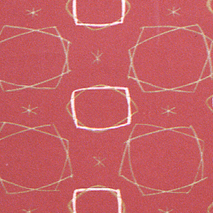 Two irregular-shaped motifs, roughly horizontal rectangles, alternate with one another in drop-repeating relationship. Both are freely drawn. Small stars, an additional motif, are found in the spaces between. Printed in olive and pink on dark red ground.