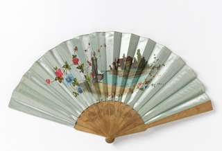 Pleated fan. Luminescent silk leaf painted with florals and small landscape with rustic building by the water. Perforated wood sticks. Horn washer at rivet.