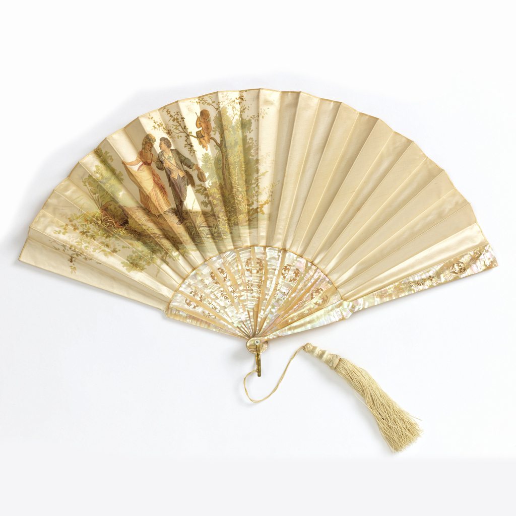 Pleated fan with a white silk leaf with chromolithograph showing a man and woman in eighteenth century-style dress with cupid. Reverse: plain stiffened cotton. Drilled and carved mother-of-pearl sticks. Metal bail, silk tassel and mother-of-pearl washer at the rivet.