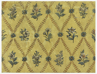 Horizontal rectangle. Vertical lozenge pattern of foliage, with floral inserts in each lozenge and floral rosettes at each angle of the lozenges. Printed in colors on mustard-yellow ground.