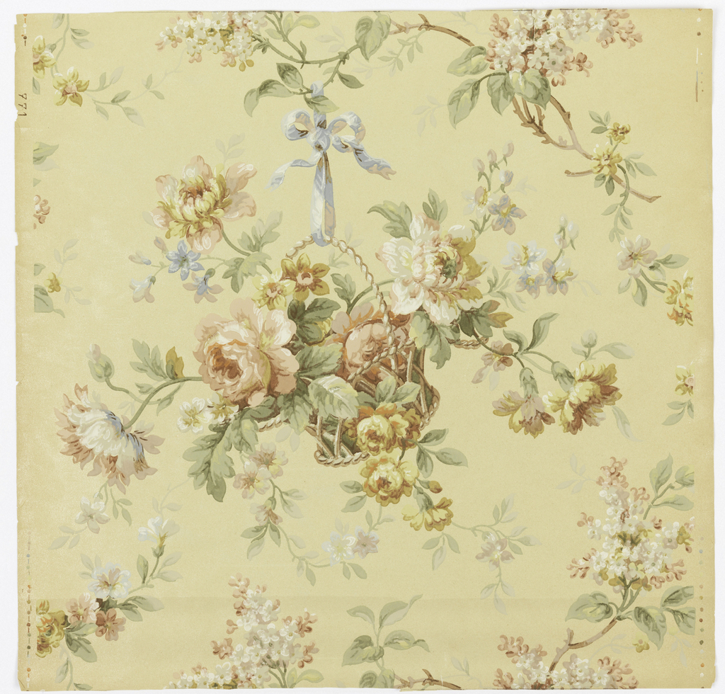 Background of cream has slight horizontal corrugation. The central motif is a basket of roses and other flowers and blossoms. The arc-shaped handle of the basket is suspended by a blue ribbon from an upper branch.