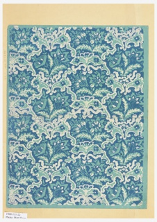 Printed thickly in blue and white on turquoise ground, small scale scrollwork and floral motifs in regular repeat, vaguely within diamond grid. Printed on small sheet with margins on all four sides.