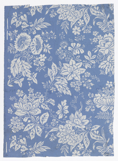 Overall various floral and leaf motifs.  Printed in grey and white on a blue ground.