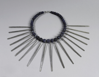 Beaded necklace, with long flat silver strips alternating with beads.
