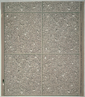 Resembles blocks of cement encrusted with pebbles of various sizes. Printed in three shades of gray, black and white.