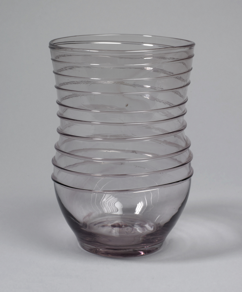 Amethyst coil wrapped baluster body, the coil applied on the cylindrical upper portion above a bulbous base.