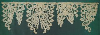 Scallops of bobbin lace forming a border.