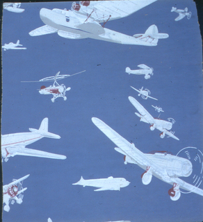 Children's wallpaper containing various styles of airplanes. The airplanes are white with red accents printed on a blue ground.