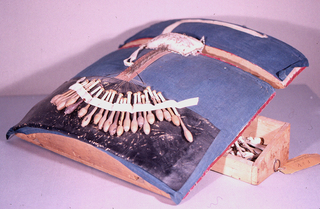 'Pillow' for making bobbin lace in two parts  with 24 bobbins of turned posts and drawer in base.